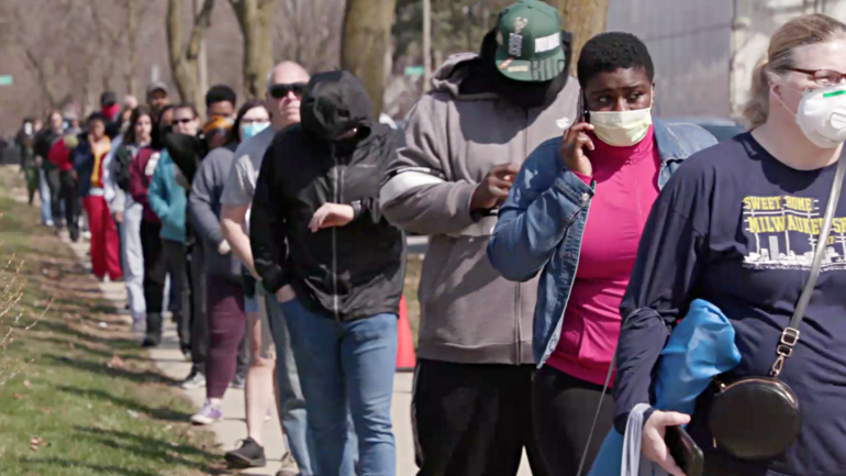 Milwaukee voters waited in line for hours as the city goes from 180 polling sites to five amid the COVID-19 pandemic April 7, 2020.