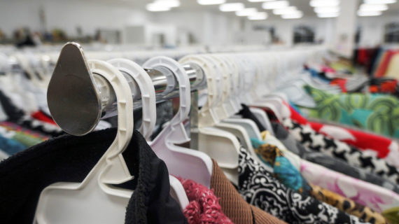 Image of a clothing rack from a thrift store. (Courtesy: Carla Burke)